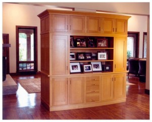 Bow front, two-sided entertainment center.