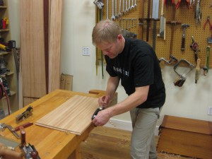 Rabbeting chest bottom to fit the grooves