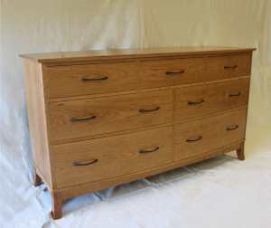 Bow-front dresser made from cherry