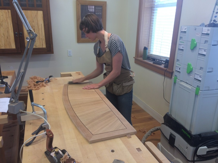 Chantel working on a group project, a beautiful sofa table made out of cherry and gum wood.
