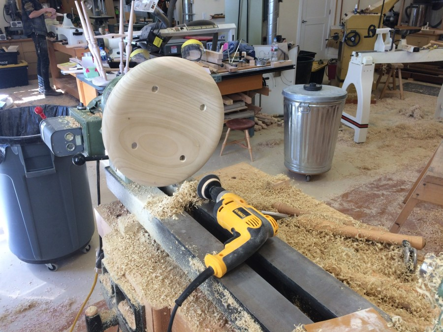A completed seat after sanding at the lathe. Notice the mess in my shop.